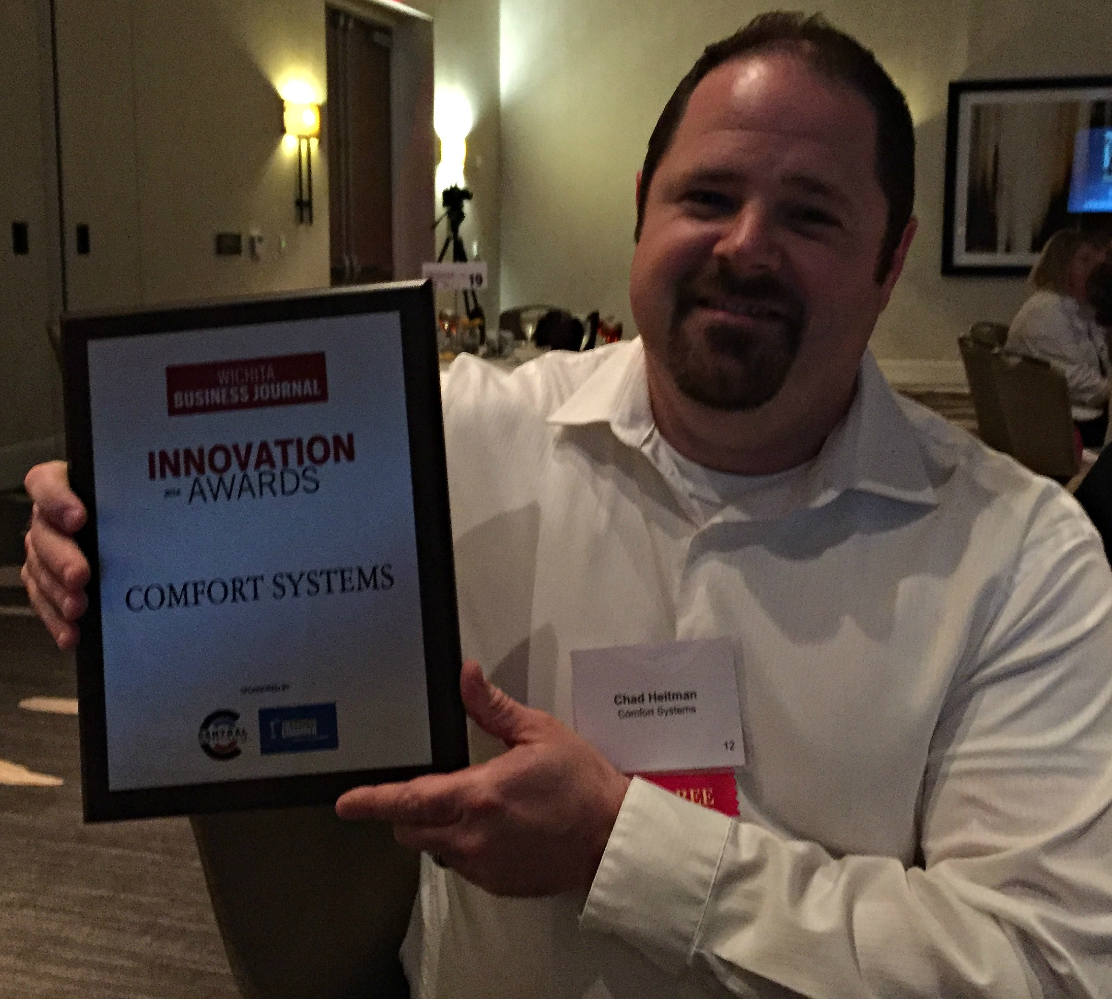 GM of Comfort Systems, Chad Heitman, accepting his innovation award